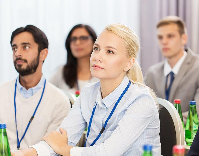 StratX_0000_Woman-studying-at-business-conference-
